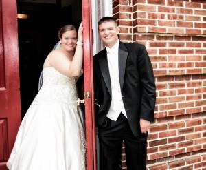 wedding photography first look with door in between