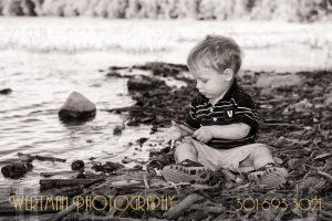 little boy by water